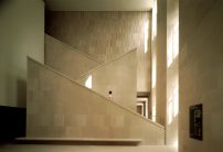 A monumental staircase guides visitors toward the Spanish and Italiand rooms